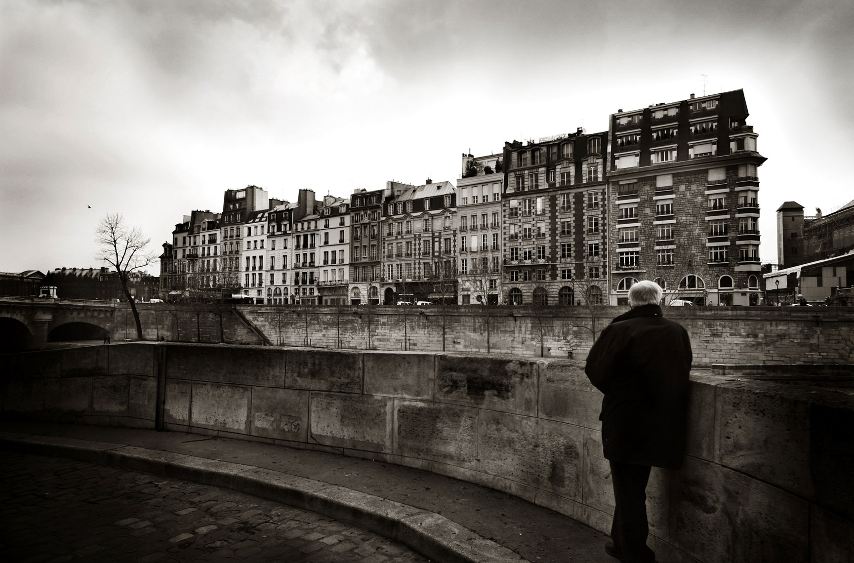 Man Standing by Seine River France