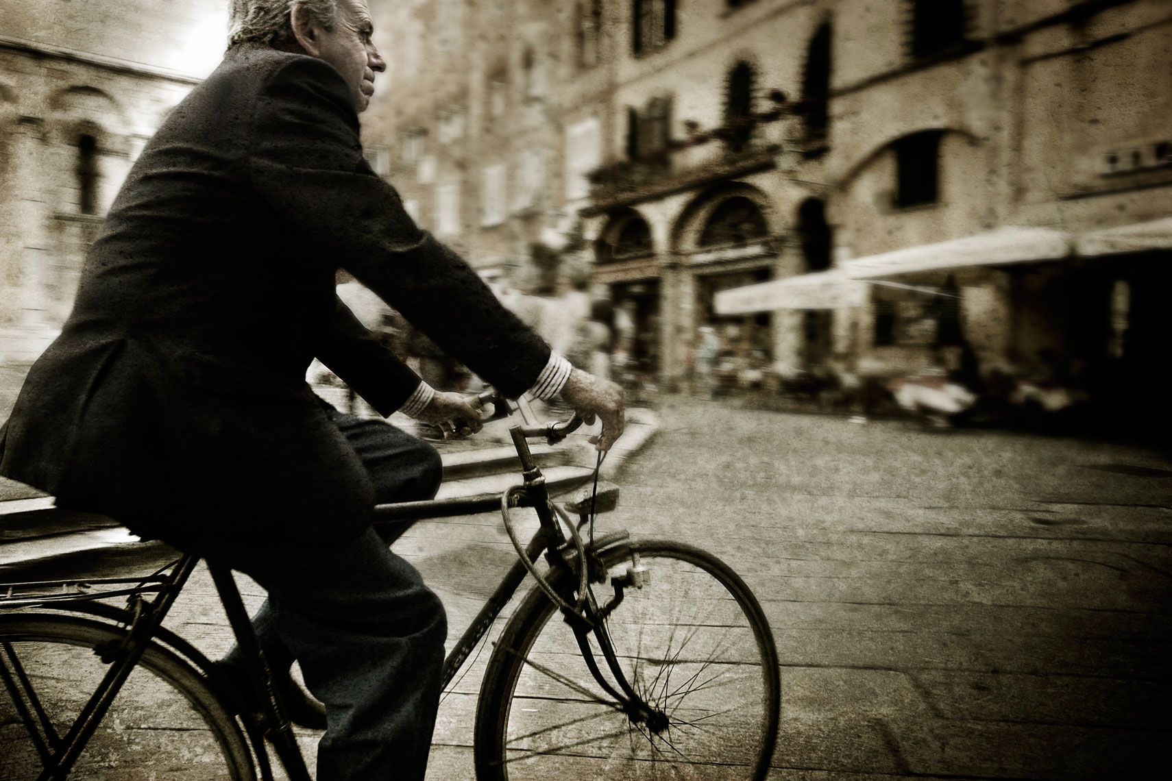 Portrait of Man on Bicycle in Italy